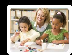 teacher teaching the kids making artwork